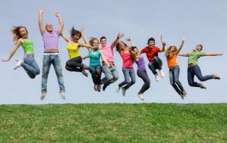 8727547 - group of teens jumpingat summer camp