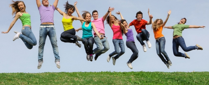 8727547 - group of teens jumpingat summer camp